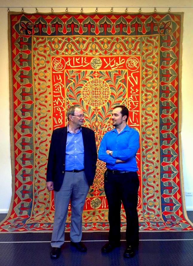 """Bob and Sam Bowker chatting in front of the """"Milan Panel"""", a Khedival Khayamiya dated 1899."""